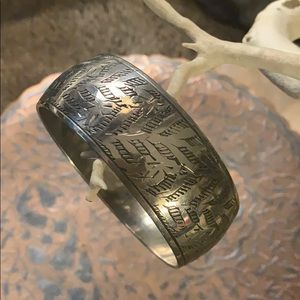 Silver bangle w Asian-inspired etching